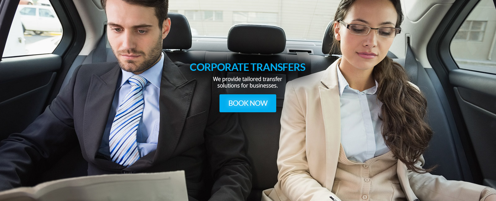 male and female sitting in back of car with words Corporate Transfers branded on image
